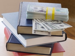 Stack of books with money