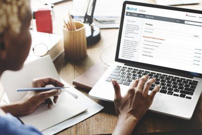 Woman accessing Pivot Profiles on a laptop
