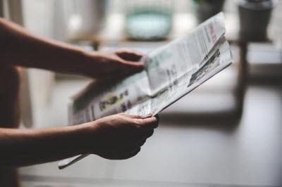 Man holding a newspaper