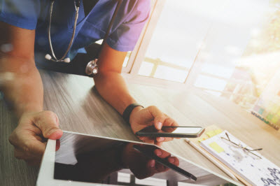Medical professional using digital devices