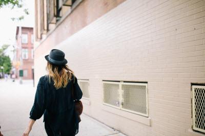 Woman walking on a sidewalk